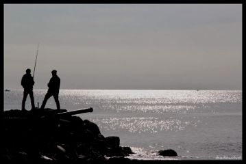 sea silence fisherman silhouette