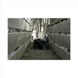girl stairs fairhair dark wood